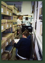 Archive aisle with volunteers